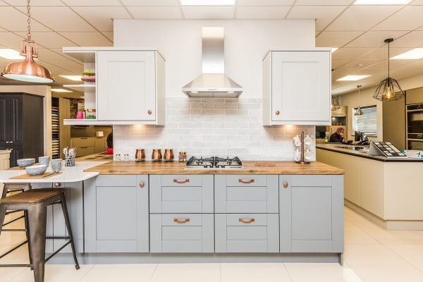 Grey kitchen - shaker kitchen in two tone colours and statement copper fixtures