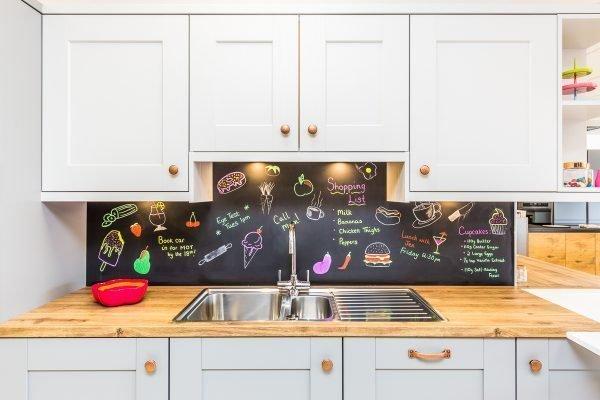 shaker kitchen in two tone colours. Grey kitchen units with blackboard backsplash