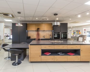 anthracite and old oak - grey kitchen unites combine with wood effect units to create stunning two tone kitchen