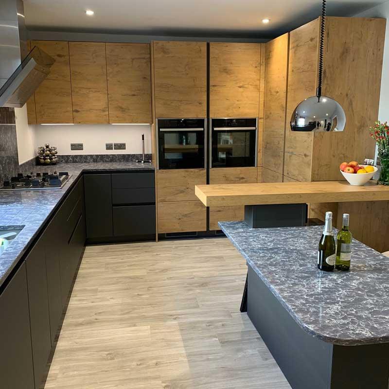 Rotpunkt Carbon HPL & Old Wild Oak kitchen units