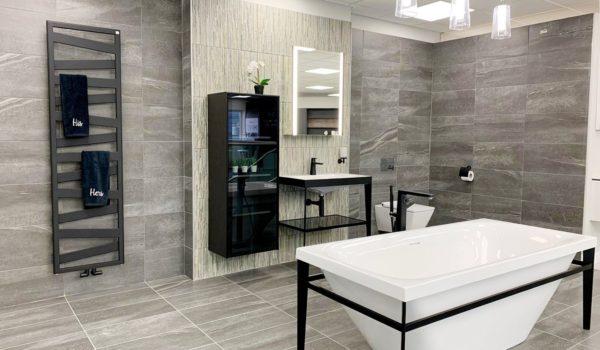 Bathroom design - modern bathroom with striking black lines and grey tiling
