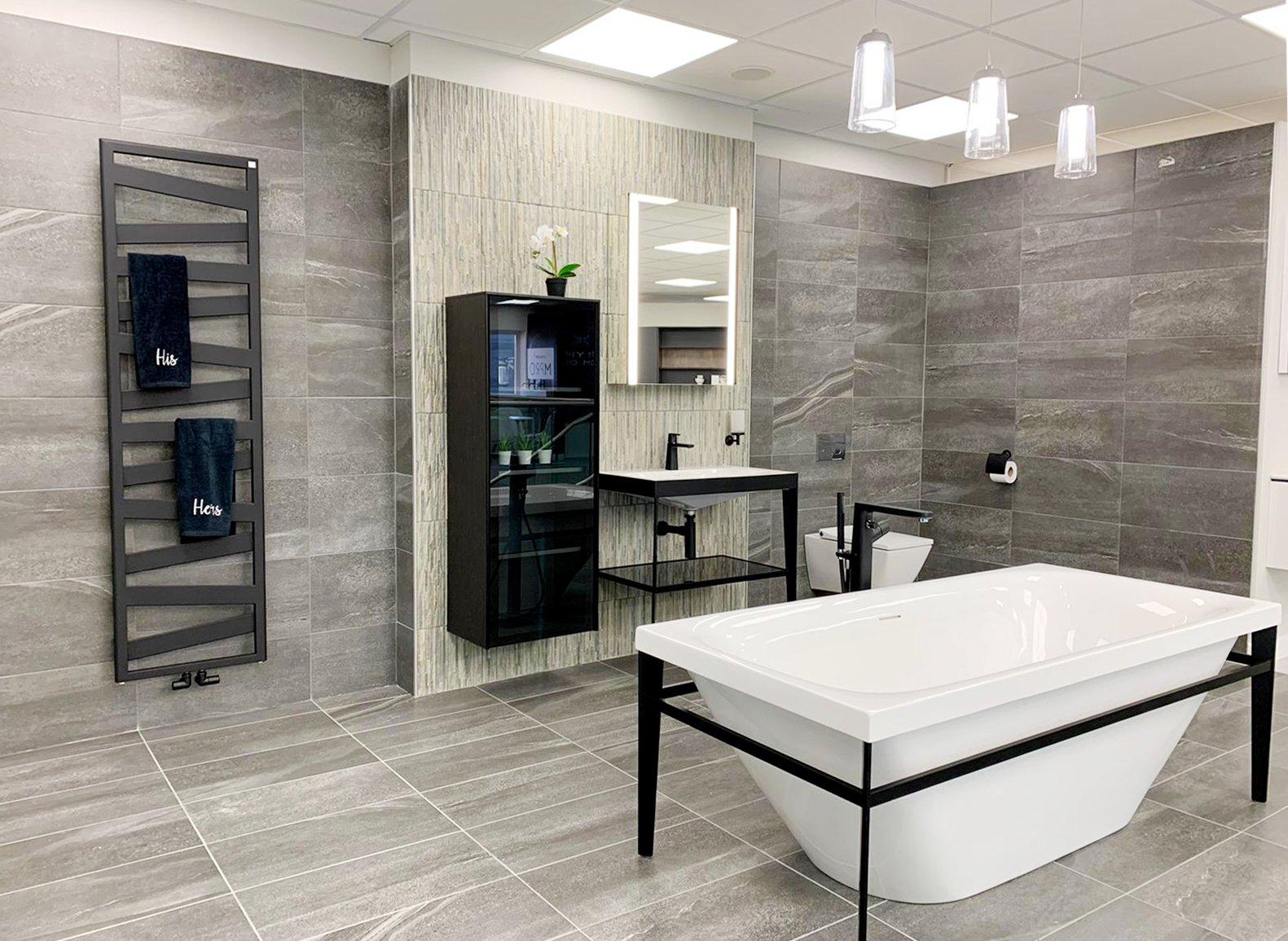 Bold black lines bathroom with statement towel radiator bathroom