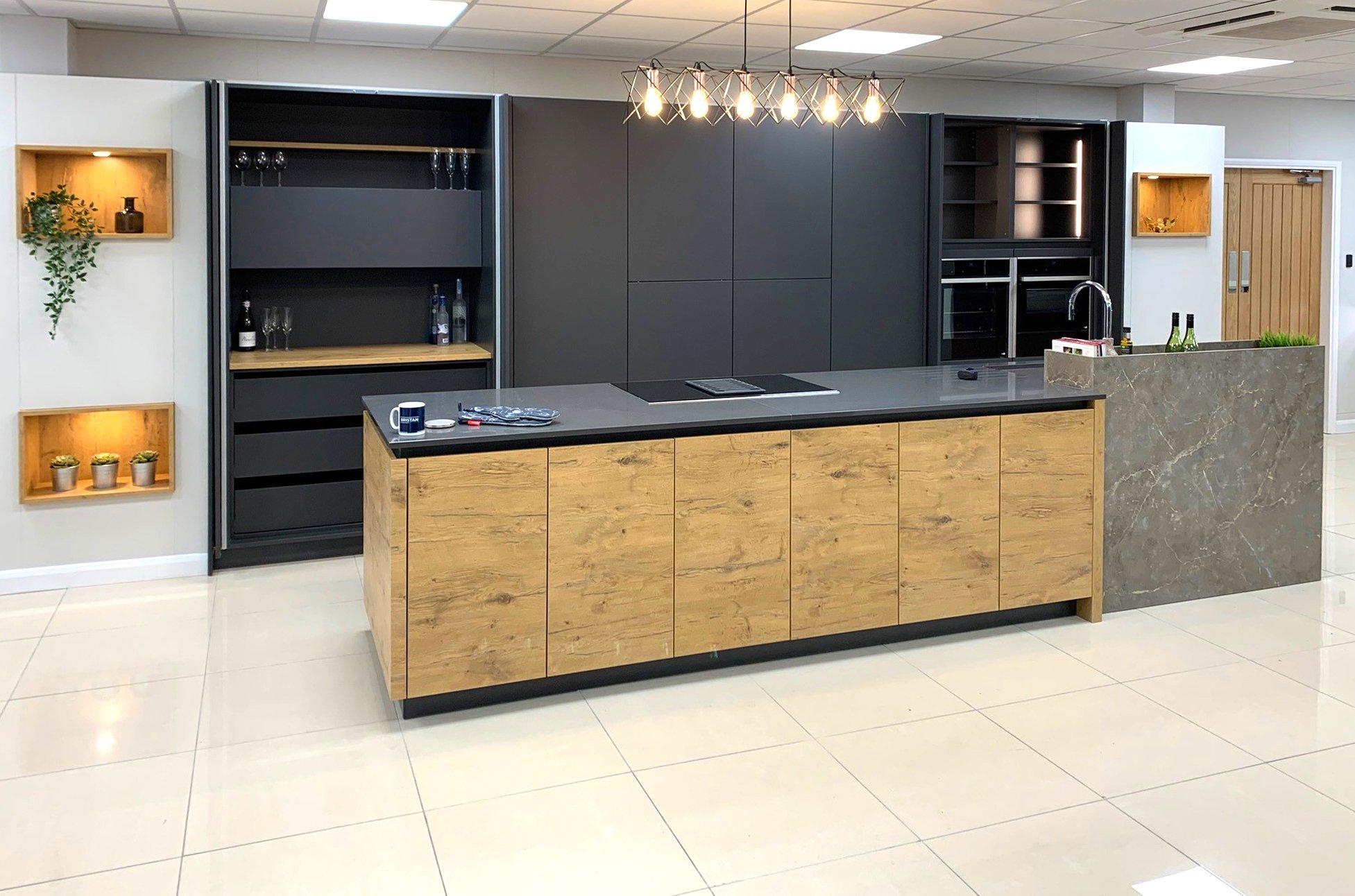 Rotpunkt Carbon and wild oak german engineered kitchen