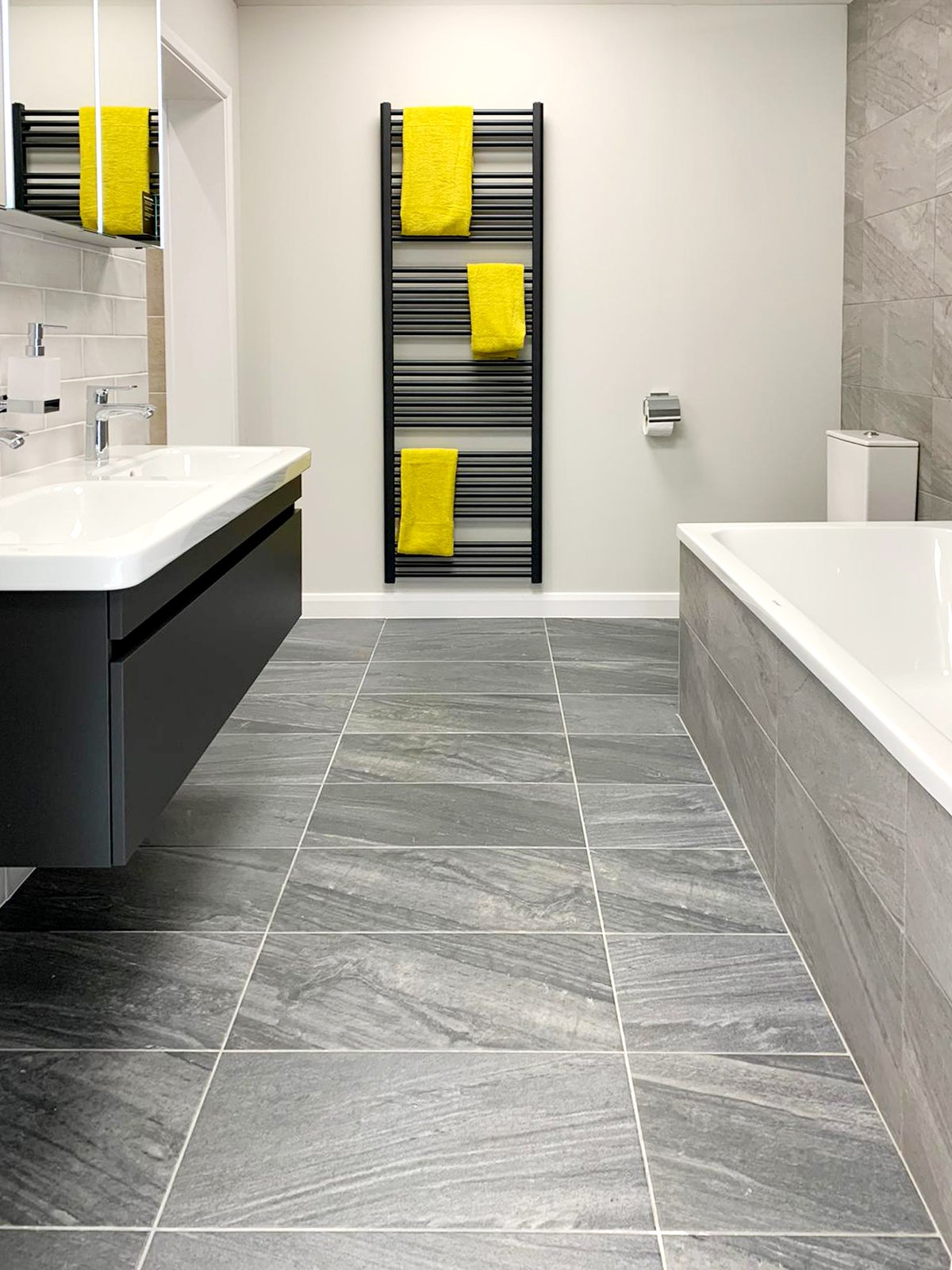 Simple contemporary bathroom with grey tiles