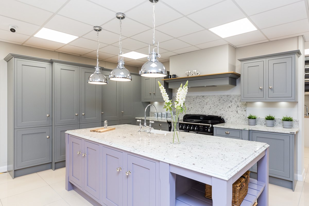 Classic Grey kitchen with grey shaker kithcen cabinets and lilac kitchen island
