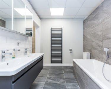Modern bathroom with grey tiling