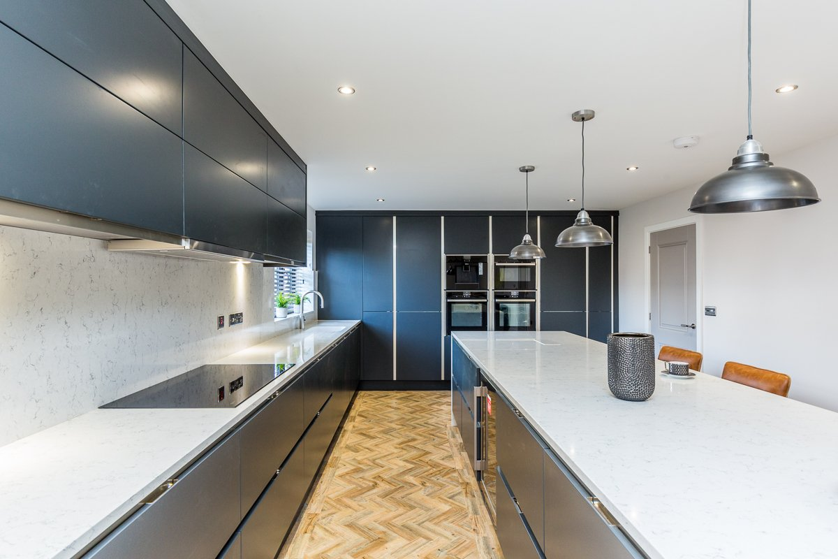Blue kitchen island with room for the whole family