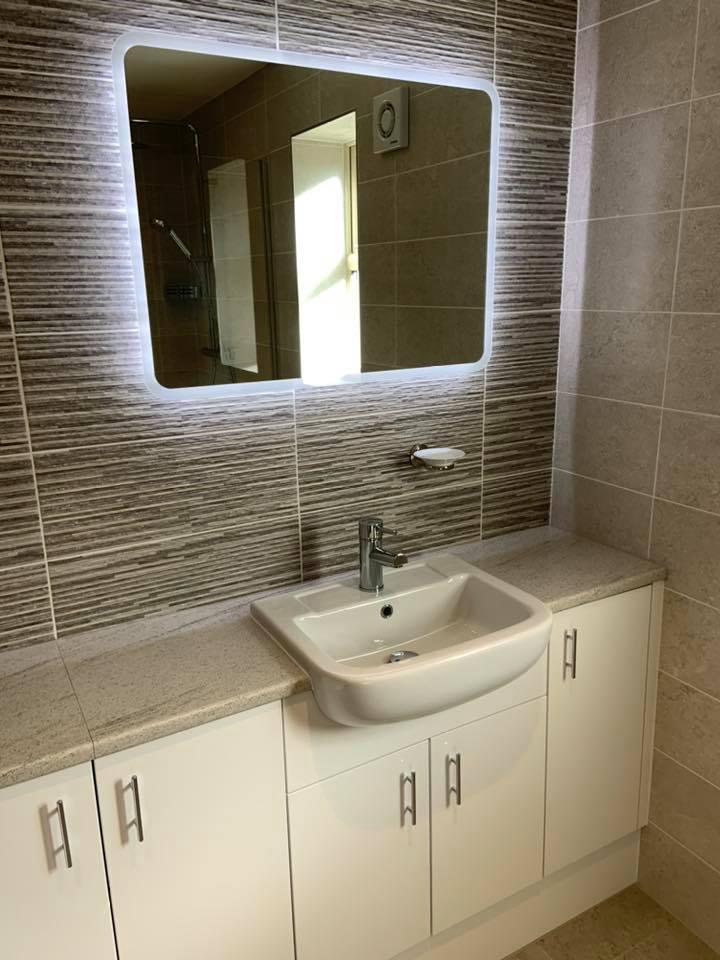 Bathroom Ideas - illuminated mirrors can really finish a space
