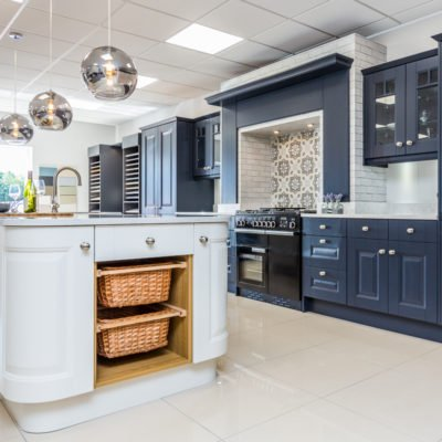 Country kitchen - two tone blue kitchen with wicker baskets