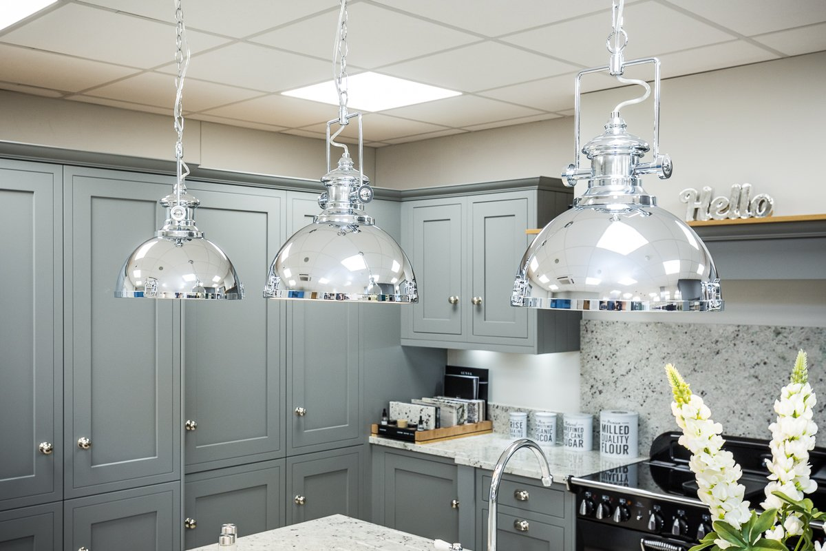 Grey Kitchen with chrome pendant lighting over a kitchen island