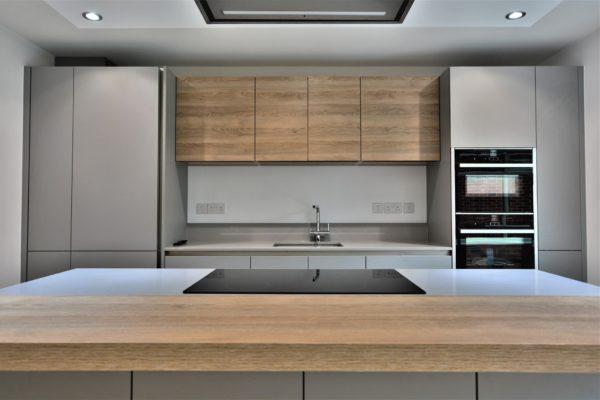 Sleek handleless Grey Kitchen with modern NEFF appliances