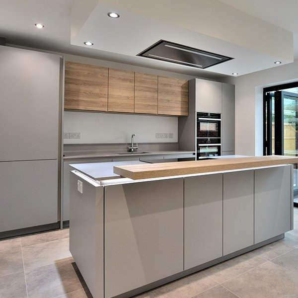 Grey kitchen with cantelevered breakfast bar on the kitchen Island - chanceoptions homes