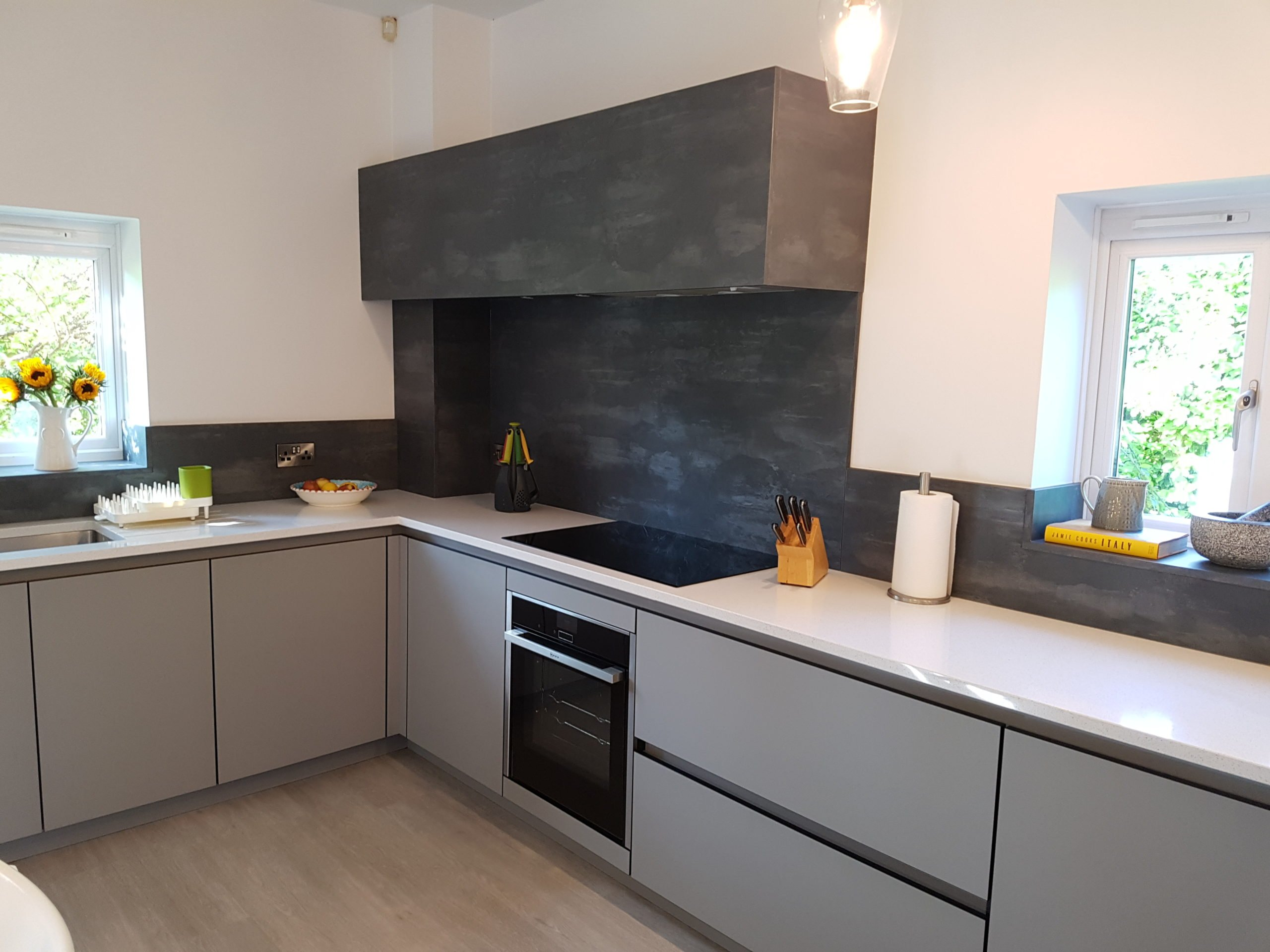 Modern grey kitchen with Charcol backsplash and extractor