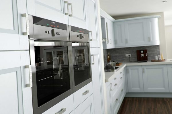 Sheraton Kitchens - Chamfered Shaker kitchen in Light Grey for a country kitchen look