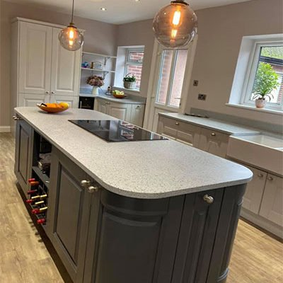 Traditional Kitchen - Country kitchen with kitchen island and pendant lighting