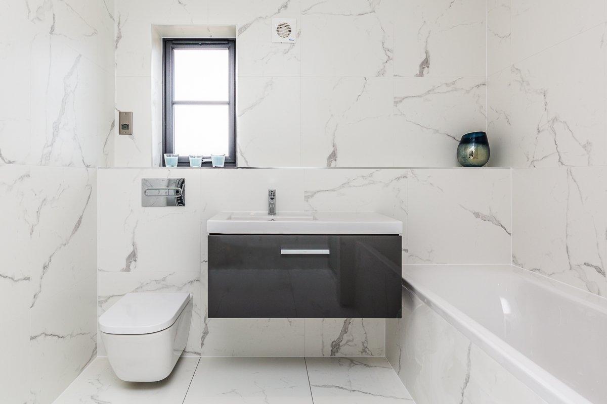marble tiles in this floor to ceiling luxury bathroom