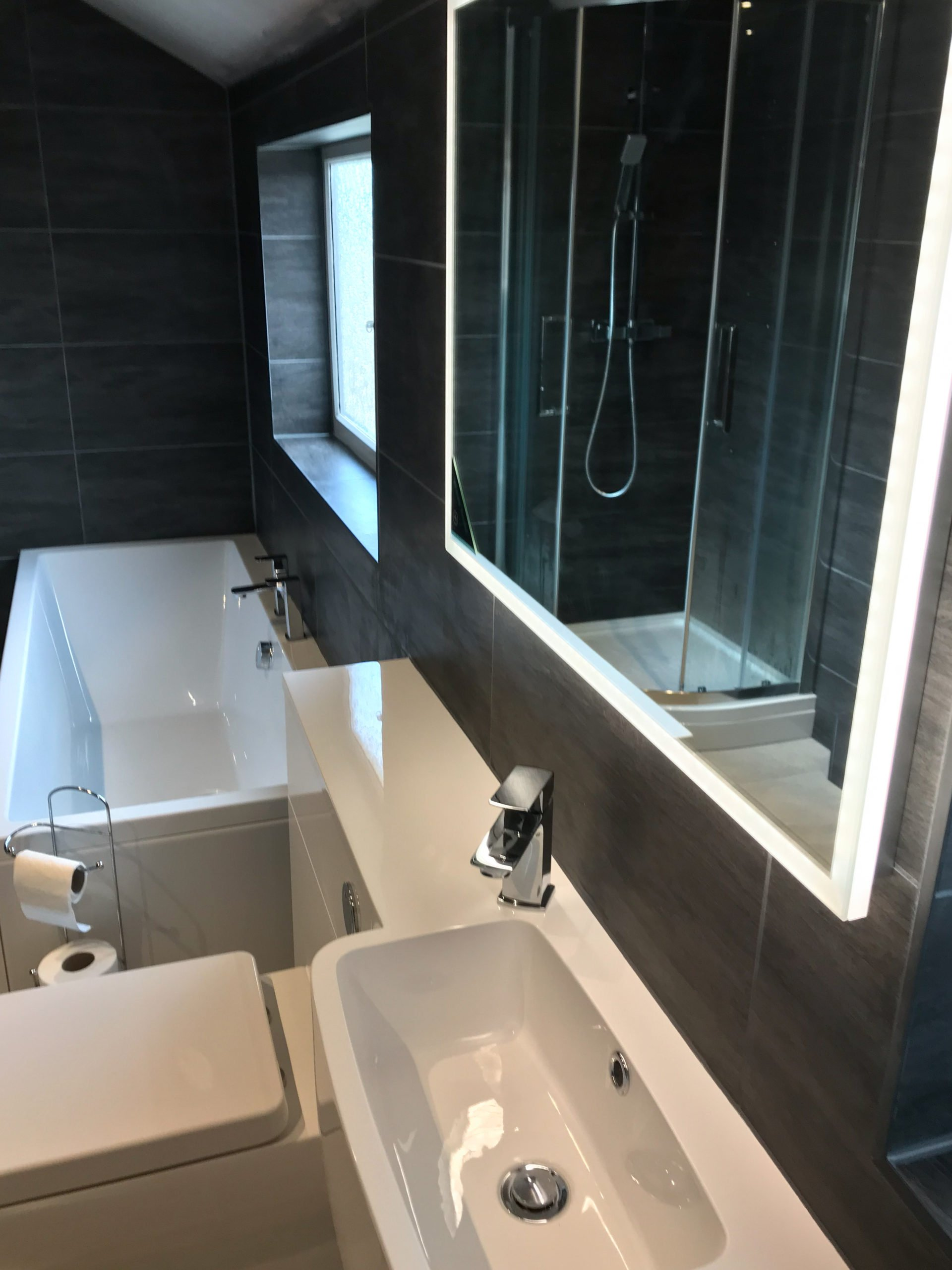 Illuminated HIB Mirror brightens up a dark Bathroom