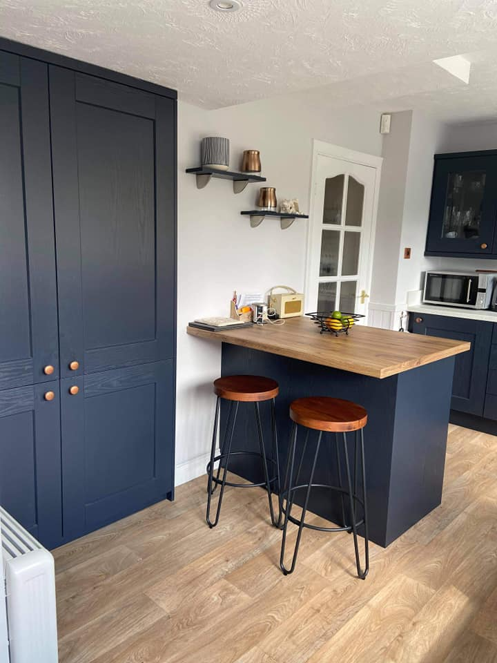Symphony Indigo kitchen with copper fixings.