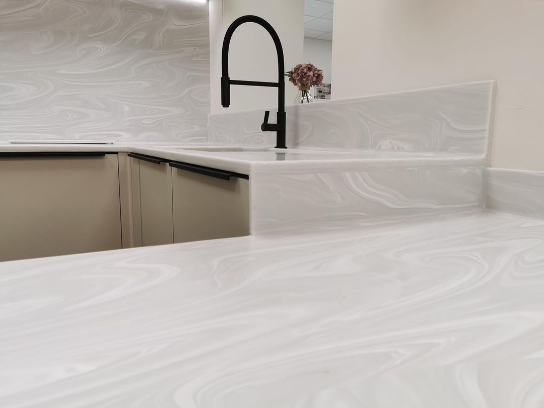 Symphony Urban Concrete & Inline Alta Gloss Pearl Grey kitchen units with Corian Grey Onyx worktops