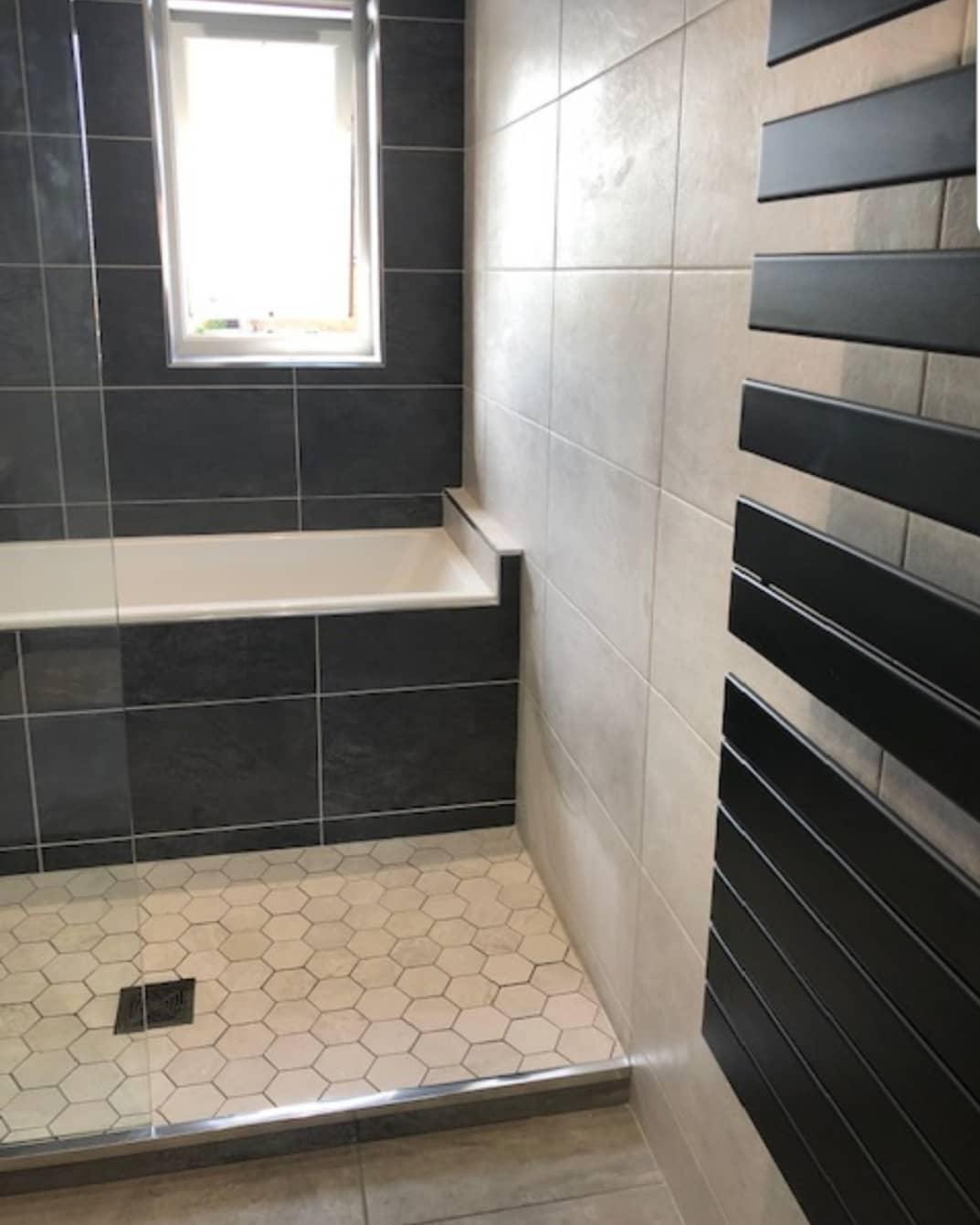 Zhender radiator in grey ensuite bathroom