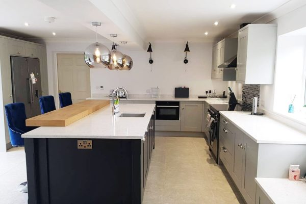 grey kitchen with island and cantelevered breakfast bar