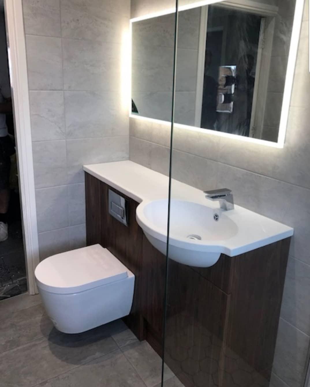 illuminated HIB mirror in this gorgeous grey bathroom