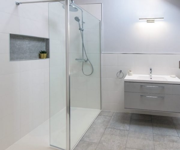 Light and neutral colours create a bright modern bathroom in this small space in a Barn Conversion in Owmby Lincolnshire