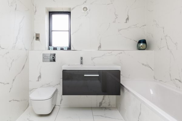 Make a small bathroom feel larger with light bright colours