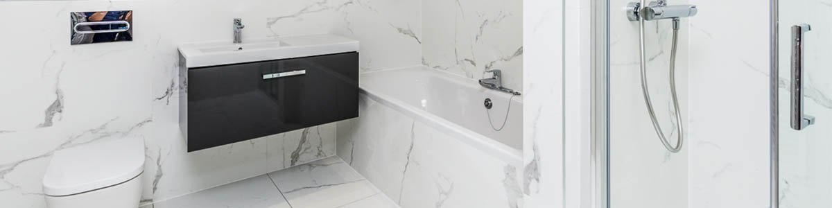 Small Bathroom in modern style with statement tiles in large marble effect
