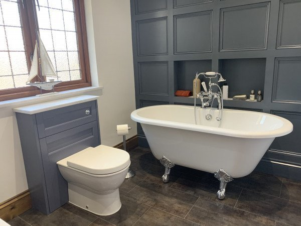 A statement freestanding bath in a Shaker bathroom